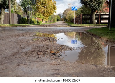 City street. Residential area. Muddy gravel road. Autumn day