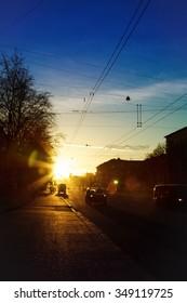 City street in winter sunset