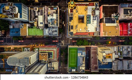 City streets at dusk as seen from above. Aerial photograph. Urban scene.