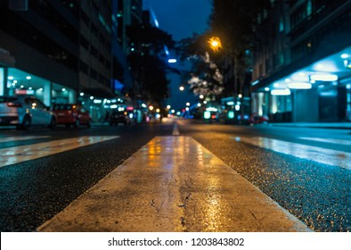 City Streets In The Rain At Night | Lights and Reflections Through Puddles On Street