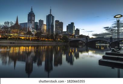 city sunrise Melbourne downtown skyline river reflections