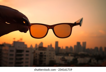 City sunset through sunglasses