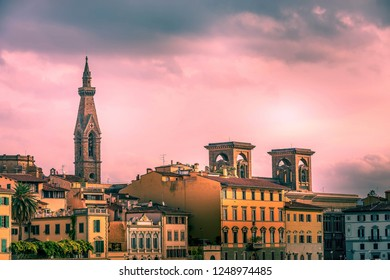 City sunset view with Basilica Santa Croce tower, houses in Florence, Italy