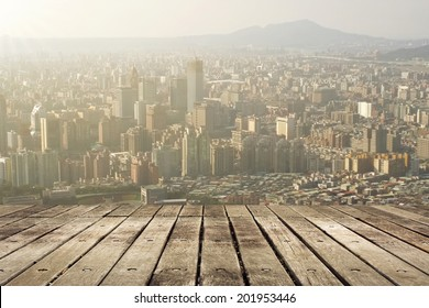 City sunset with wooden ground.