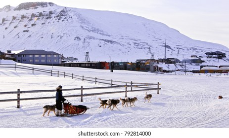 The city is surrounded by mountains. Longyearbyen, Spitsbergen (Svalbard). Norway, A city details of Longyearbyen - the most Northern settlement in the world.Husky dog relay with dogteam-driver.