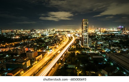 city in Thailand in the night.can see light on the road.