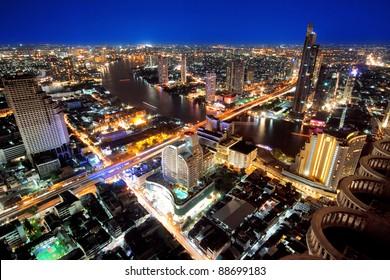 City town at night, Bird eyes view from Sky Bar at Sirocco, Bangkok, Thailand