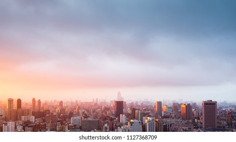 City town with sunset sky background. Landscape of city background.