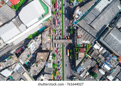 City traffic with modern building top view from drone