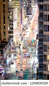 City traffic at night, aerial view of main avenue, New York City.