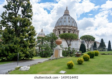 City trip to Rome and Vatican; roundtrip around Vatican gardens with beautiful green zones, lawn and trees