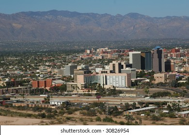 City of Tucson, seen with mountains in the background, as well as the University of Arizona