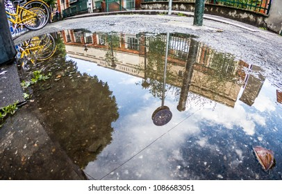 city of Turin reflected in the puddle and inverted