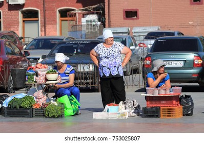 City of Tyumen, Russia, July 12, 2013: Tyumen farmers with vegetables and fruits on the square. Business in Siberia.