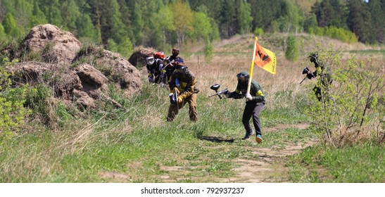 The city of Tyumen, Russia, May 17, 2014: Soldiers go battle with flags. Sports Paintball