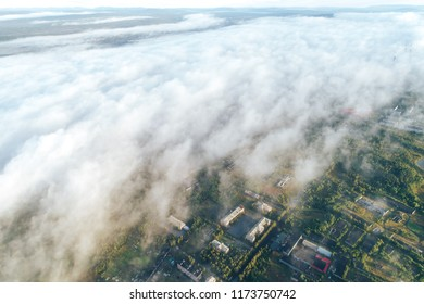City under the Low Cloud Cover. Aerial View from the Drone. Townscape of Kandalaksha Town located in Kola Peninsula in Nothern Russia