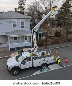 City utility electrical workers bucket boom truck, Revere Massachusetts USA, February 12, 2020