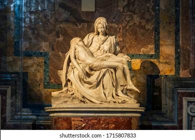 """City of Vatican, Vatican. 01 08 2020: La Pieta (""""The Pity"""") Renaissance sculpture by Michelangelo inside St. Peter's Basilica (San Pietro)."""