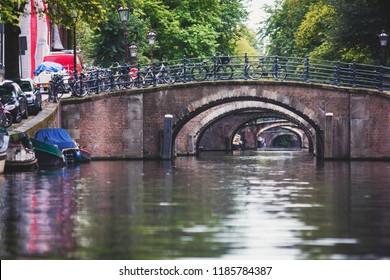 City view of Amsterdam canals with bridges and bicycles, Netherlands