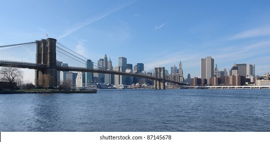 city view of New York (USA) with Brooklyn Bridge and East River in sunny ambiance