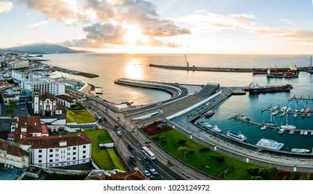City view on the old town with harbor at Ponta Delgada, capital city of the Azores at Sao Miguel Island. Beautiful aerial old town by the ocean.