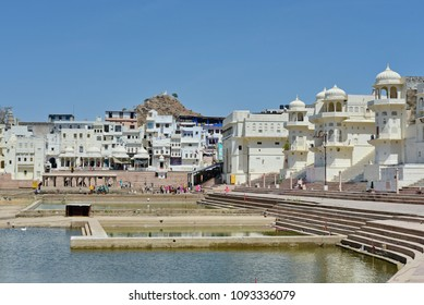 The City view of Pushkar, Rajasthan, India. One of the secret place for hinduism in India. Very famous for its temple.Hindu pilgrims bathing in sacred Lake Pushkar (Sarovar) on ghats. Countless people