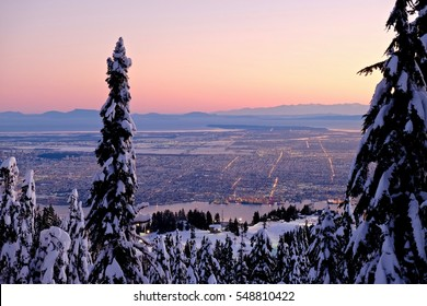 City view at sunrise in winter. Grouse Mountain. North Vancouver. British Columbia. Canada.