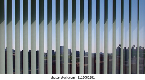 City view through vertical blinds