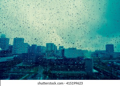 City view through a window on a rainy day