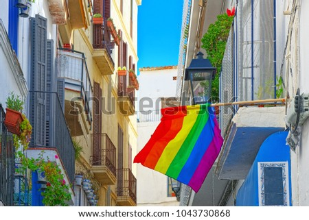 City views and gay flags on buildinds in a small town in the outskirts of Barcelona - Sitges. Spain.