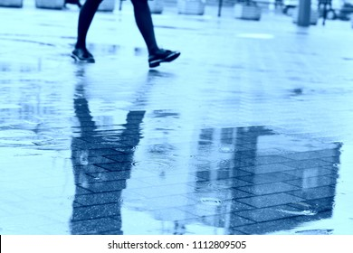 City walking or Rainy day. Go your own way. Time is money. Monday morning. Sad people. Sad mood. On foot. Walking alone. Raining.