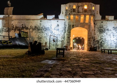 city wall and entrance to historic center of Campeche by night, Mexico