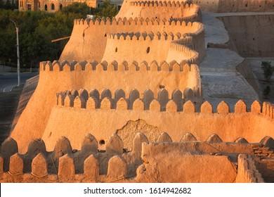 City walls of the ancient city of Khiva at the sunset , Uzbekistan
