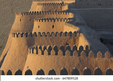 City walls of the ancient city of Khiva in Uzbekistan, at the sunset.