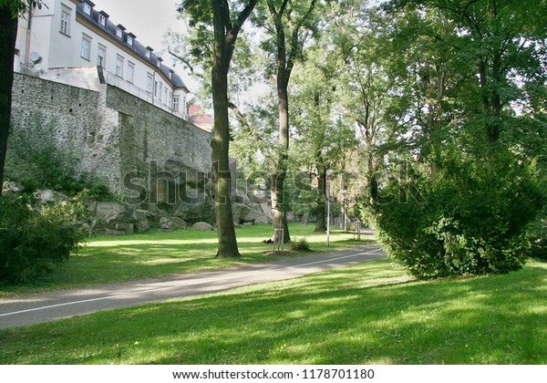 City walls of Olomouc of the Czech Republic are lined with a park made of old trees, maintained by bushes and lawns. The relaxing walkway and the cyclist's trail are widely used.