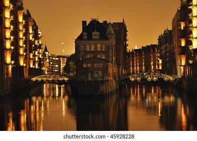 City of warehouses by night Hamburg Germany.