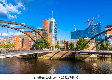 City of Warehouses district (Speicherstadt) in Hamburg, Germany. Building of Elbphilharmonie (Elbe Philharmonic Hall) on background. Niederbaumbrucke Bridge on foreground