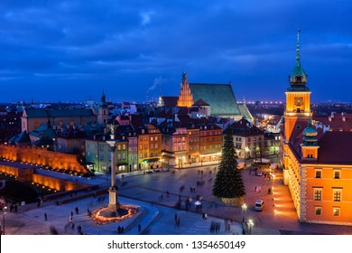 City of Warsaw by night in Poland, Castle Square in the Old Town, picturesque urban landscape of the capital city.