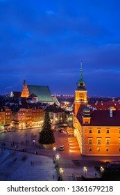 City of Warsaw by night in Poland, Castle Square in the Old Town, view from above.