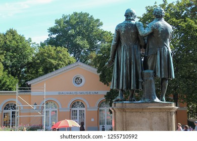 City Weimar, Thuringia/Germany- September 20, 2018. Famous german writers Goethe-Schiller Monument in front of the Deutsches Nationaltheater in Weimar