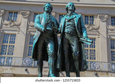 City Weimar, Thuringia/Germany-Famous german writers Goethe-Schiller Monument in front of the Deutsches Nationaltheater in Weimar