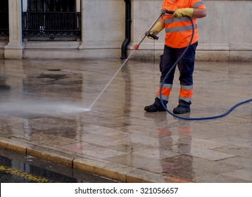 City workers - cleaning and washing of city streets