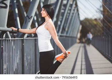 City workout. Beautiful young woman training in an urban setting