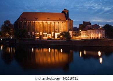 City of Wroclaw in Poland, Sand Island (Wyspa Piasek), Church of Our Lady on Sand by night at Odra (Oder) river, 14th century Gothic architecture.