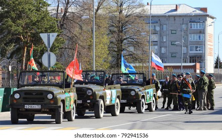 City Yalutorovsk, Tyumen region, Russia, May 9, 2016: Column of soldiers and military cars in the city of Yalutorovsk. Parade to the Victory Day.