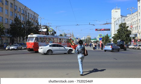 City of Yekaterinburg, Russia, July 30, 2014: Woman and tram in Yekaterinburg. Streets in the capital of the Urals.
