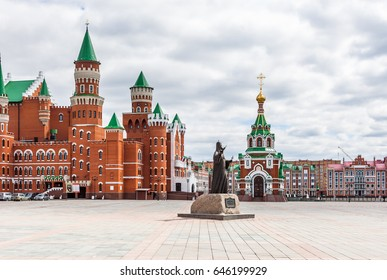 City of Yoshkar-Ola, Republic of Mari El, Russian Federation. May 5, 2017. The embankment of Bruges (Bryugge). The palace, the house, the square. Chapel of Peter and Fevronii Muromskih. The monument.