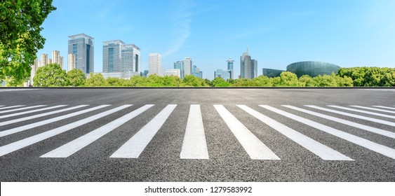 City zebra crossing road and modern commercial buildings in Shanghai