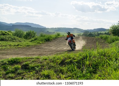 City: Zilina, Country: Slovakia. Date: 4-Apr-2018: Motorcyclist riding off road during sunset. Not an oofficial event. Slovakia