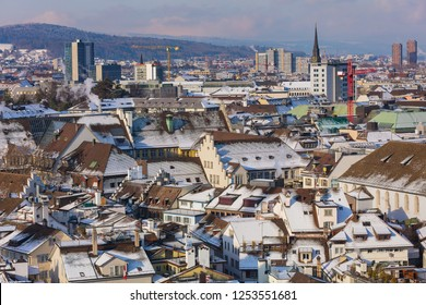 The city of Zurich in Switzerland as seen from the tower of the Grossmunster cathedral in winter. Zurich is the largest city in Switzerland and the capital of the Swiss canton of Zurich.